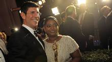 Rich Ross, chairman of Walt Disney Co.'s movie studio, stands with actress Octavia Spencer with the award for best actress in a supporting role for The Help at the Governors Ball following the 84th Academy Awards on Feb. 26, 2012. (Chris Pizzello/AP/Chris Pizzello/AP)