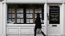 "A woman walks past an estate agent in Chelsea, London Feb. 7, 2013. London's property is losing its attraction for investors as they start to venture out of ""safe havens"" and worry that the city's prices look high given a slowing British economy. (STEFAN WERMUTH/Reuters)"
