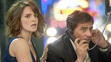 In the midst of the date night from hell, Claire (Tina Fey) and Phil (Steve Carell) make a frantic call for help.
