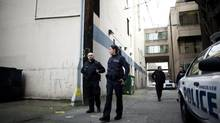 Vancouver policer officers leave for patrol from an alley outside the old Main Street police headquarters in the Downtown Eastside in March 2013. (Rafal Gerszak for The Globe and Mail)
