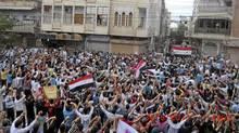 Demonstrators protesting against Syria's President Bashar al-Assad march through the streets in Homs September 30, 2011. Picture taken September 30, 2011. (REUTERS)