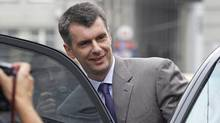Russian tycoon Mikhail Prokhorov gets in a car after his news conference in Moscow, Russia, Thursday, Aug. 11, 2011. (Mikhail Metzel/The Associated Press/Mikhail Metzel/The Associated Press)