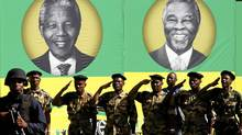 Members of the Umkhonto We Sizwe Military Veterans Association (MKMVA) salute in front of posters of former presidents of the African National Congress (ANC), Nelson Mandela (L) and Thabo Mbeki, during the ANC's centenary celebration in Bloemfontein Jan. 8, 2012. (SIPHIWE SIBEKO/Reuters/SIPHIWE SIBEKO/Reuters)