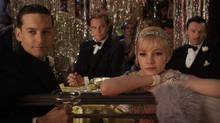 """(L-r) Tobey Maguire as Nick Carraway, Leonardo DiCaprio as Jay Gatsby, Carey Mulligan as Daisy Buchanan and Joel edgerton as Tom Buchanan in a scene from """"The Great Gatsby"""" (Courtesy of Warner Bros. Pictures)"""