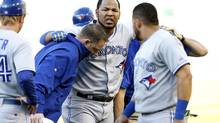 Toronto Blue Jays first baseman Edwin Encarnacion (10) leaves the field after injuring himself at first base during the first inning against the Oakland Athletics at O.co Coliseum, July 5, 2014. (Robert Stanton/USA Today Sports)