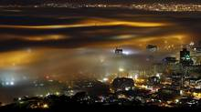 REFILE - CORRECTING DATE Seasonal fog is illuminated by the lights of Cape Town harbour as the city prepares for the start of the southern hemisphere winter, May 8, 2012. REUTERS/Mike Hutchings (SOUTH AFRICA - Tags: ENVIRONMENT TPX IMAGES OF THE DAY) (MIKE HUTCHINGS/Mike Hutchings/REUTERS)