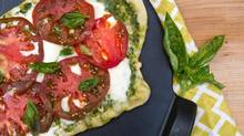 Lucy Waverman prepares a Caprese-style pizza of heirloom tomatoes, arugula pesto, fresh mozzarella cheese and fresh basil, Thursday, July 31, 2014. (Galit Rodan For The Globe and Mail)