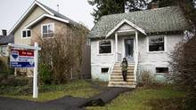 A house with an asking price of $2.4 million at 4453 West 14th Avenue is pictured during an open house in Vancouver, British Columbia on February 2, 2015. (Ben Nelms For The Globe and Mail)