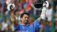 FILE - In this Feb. 27, 2011 file photo, India's Sachin Tendulkar celebrates his century in the Cricket World Cup Group A match between England and India in Bangalore, India. India's media and former cricketers have united in celebrating Sachin Teldulkar's 40th birthday, as speculation continues over when the prolific batsman will end his international career. (Kirsty Wigglesworth/AP)