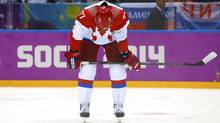Russia's Anton Belov reacts after a loss to Finland in their men's quarter-finals ice hockey game at the 2014 Sochi Winter Olympic Games, February 19, 2014. (Reuters)