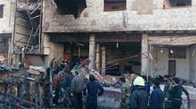 Residents and soldiers loyal to Syria's President Bashar al-Assad inspect damage after a suicide attack in Sayeda Zeinab, a district of southern Damascus, Syria January 31, 2016. At least 60 people were killed, including 25 Shi'ite fighters, and dozens wounded on Sunday by a car bomb and two suicide bombers in the district of Damascus where Syria's holiest Shi'ite shrine is located, a monitor said. Sunni fundamentalist Islamic State claimed responsibility for the attacks, according to Amaq, a news agency that supports the group. (REUTERS)