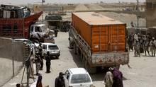 Pakistani border guards stand alert at the Pakistan-Afghanistan border in Chaman, Pakistan, Thursday, July 5, 2012 (Matiullah Achakzai/The Associated Press)