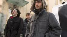 Ahmed Al-Khabaz, a Dawson College student who was expelled after discovering a security breach in a school computer system, stands in front of the school, Tuesday, January 22, 2013 in Montreal. (CP)