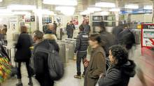 TTC users come and go through the entrance to the TTC in Toronto on March 1, 2011. (Peter Power/The Globe and Mail/Peter Power/The Globe and Mail)