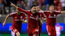 Toronto FC's Jonathan Osorio and his teammates celebrate after defeating the Vancouver Whitecaps (Darryl Dyck/The Canadian Press)