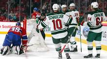 Minnesota Wild center Mikael Granlund (64) celebrates his goal against Montreal Canadiens goalie Mike Condon (39) with teammates during the first period at Bell Centre in Montreal on Saturday, March 12, 2016. (Jean-Yves Ahern/USA Today Sports)