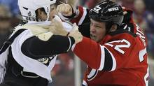 Pittsburgh Penguins defenceman Deryk Engelland and New Jersey Devils right wing Krys Barch (22) fight in the first period of their NHL hockey game in Newark, New Jersey, February 9, 2013. (RAY STUBBLEBINE/REUTERS)