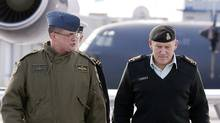 Interim CFB Trenton commander Lieutenant-Colonel Dave Murphy, left, walks with General Walter Natynczyk on the base. (Ben Nelms for The Globe and Mail)