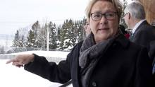 Parti Quebecois Leader Pauline Marois checks the view while campaigning on March 22 in Notre-Dame-du-Portage. (Jacques Boissinot/THE CANADIAN PRESS)