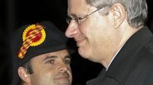 Prime Minister Stephen Harper arrives in Geneva, Switzerland, on Oct. 21, 2010. (Sean Kilpatrick/THE CANADIAN PRESS)