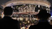People gather at a makeshift memorial for the victims of Paris' attacks at the Place de la Republique in Paris, on November 15, 2015, two days after a series of deadly attacks. Islamic State jihadists claimed a series of coordinated attacks by gunmen and suicide bombers in Paris that killed at least 128 people in scenes of carnage at a concert hall, restaurants and the national stadium.AFP PHOTO / FRANCK FIFEFRANCK FIFE/AFP/Getty Images (FRANCK FIFE/AFP/Getty Images)