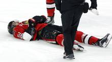 Ottawa Senators' Mark Stone lies injured on the ice after being hit by the Winnipeg Jets' Jacob Trouba on Feb. 19, 2017. (Fred Chartrand/The Canadian Press)