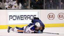 Edmonton Oilers Ryan Jones receives attention after being hit in the back by Dallas Stars Jamie Benn (not pictured) during the third period of their NHL hockey game in Dallas, Texas February 28, 2013. (MIKE STONE/REUTERS)
