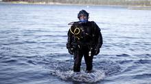 University of Victoria masters student Mike Irvine will appear before a panel of academics to defend his thesis, the penultimate step before graduation, underwater as he is photographed in Saanich, B.C., April 15, 2015. (Chad Hipolito for The Globe and Mail)