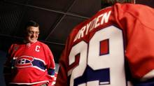 Montreal Canadiens hockey great Serge Savard looks to colleague Ken Dryden after a news conference to announce the impending retirement of their sweater numbers, in Montreal on Wednesday, September 20, 2006. (Ian Barrett/Ian Barrett/CP File)