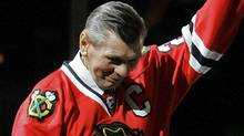 Chicago Blackhawks great Stan Mikita waves to fans as he is introduced before an NHL hockey game against the San Jose Sharks in Chicago, Friday, March 7, 2008. The long-estranged Hall of Famer was named ambassador to the team and were honored in front of a sold-out crowd. (AP Photo/Brian Kersey) (Brian Kersey)