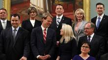Minister of Citizenship and Immigration Chris Alexander (C) and Minister of State (Western Economic Diversification) Michelle Rempel shares a smile during a group photo of the new cabinet July 15, 2013 at Rideau Hall in Ottawa. (DAVE CHAN FOR THE GLOBE AND MAIL)
