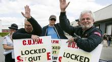 Locked-out Canada Post employees wave to passing motorists outside a postal facility in Dartmouth, N.S. on Wednesday, June 22, 2011. (Andrew Vaughan/CP)