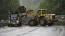 An excavator begins clearing tons of debris. (Andy Clark/Reuters/Andy Clark/Reuters)