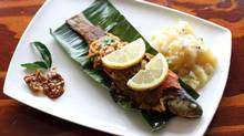 Ontario rainbow trout whole-steamed in banana leaf. (Tim Fraser/Tim Fraser for The Globe and Mail)