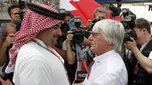 Crown Prince Sheikh Salman bin Hamad al-Khalifa greets Formula One commercial supremo Bernie Ecclestone before the Bahrain F1 Grand Prix at the Sakhir circuit in Manama on Sunday. (HAMAD I MOHAMMED)