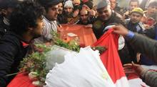 Relatives of slain opposition leader Chokri Belaid leave the house of his father while carrying the coffin prior to his funeral in Tunis, Feb. 8, 2013. (Amine Landoulsi/AP)