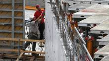 Construction work being done on a condominium construction site at Bathurst Street and Fork York Blvd. in Toronto on May 29, 2012. (Deborah Baic/Deborah Baic/The Globe and Mail)