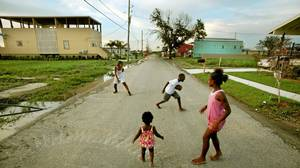 Young residents play football near their home in a new development built by the Make it Right Foundation in the Lower Ninth Ward in New Orleans. The foundation is constructing homes for families who lost theirs to Hurricane Katrina.