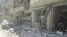 Building damaged by shelling in central Aleppo, Syria, on Aug. 6, 2012. Today's topics: Syria's 2001?, and other letters to the editor (HANDOUT/REUTERS)