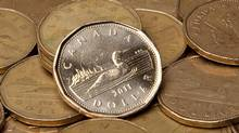 Canadian dollars (loonies). (JONATHAN HAYWARD/THE CANADIAN PRESS)