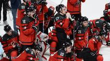 Canada players look on as the United States celebrate their victory in gold medal game hockey action at the IIHF World Junior Championship, Thursday, January 5, 2017 in Montreal. (Ryan Remiorz/The Canadian Press)