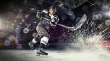Hockey player with Powershot-enabled stick. (Quattriuum)