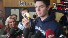 Montreal Canadiens and Team Canada goaltender Carey Price shows his gold medal to the media at the team's practice facility Monday, February 24, 2014 in Brossard, Que. (Ryan Remiorz/THE CANADIAN PRESS)