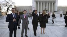 The plaintiffs in The Case Against 8 wave to the crowd as they enter the US Supreme Court.