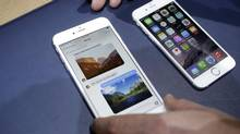 The iPhone 6 plus, left, and iPhone 6 are displayed, in Cupertino, Calif. The latest devices are out for the holiday shopping season, and there's likely to be a lull in new releases until next spring. (Marcio Jose Sanchez/AP)