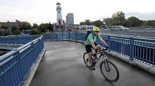 Darrin Wolter, a Citizen Member of the Mississauga Cycling Advisory Committee riding his bike in the Port Credit area of Mississauga (Deborah Baic/The Globe and Mail/Deborah Baic/The Globe and Mail)