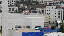 Blue tarp covers the entrance to Yasser Arafat's mausoleum in the West Bank city of Ramallah. (Nasser Shiyoukhi/AP)