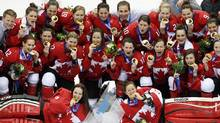 Canadian women's hockey team celebrate after beating the USA 3-2 to win the women's gold medal ice hockey game in overtime at the 2014 Winter Olympics, Thursday, Feb. 20, 2014, in Sochi, Russia. (John Lehmann/Globe and Mail)