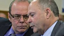 Michel Arsenault, left, president of the FTQ union and of the Fond de Solidarité of the FTQ, and Yvon Bolduc, president and director general of the Fond de Solidarite, chat before testifying at a legislature committee, Tuesday, Nov. 5, 2013 at the legislature in Quebec City. (Jacques Boissinot/The Canadian Press)