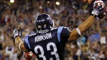 Toronto Argonauts fullback Jeff Johnson celebrates his touchdown against the Calgary Stampeders during the second half of their CFL football game in Toronto July 14, 2010 (MARK BLINCH/Reuters)